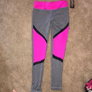 Multi colored workout pants. New with tags